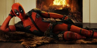 Deadpool laying by the Fire
