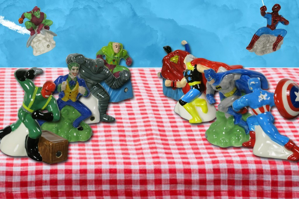 A table displaying comic book salt and pepper shakers