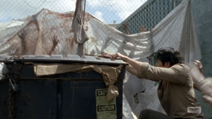 Glenn mounting a dumpster for safety in The Waking Dead!