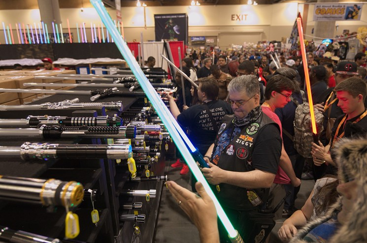 Attendees admiring the UltraSabers booth.